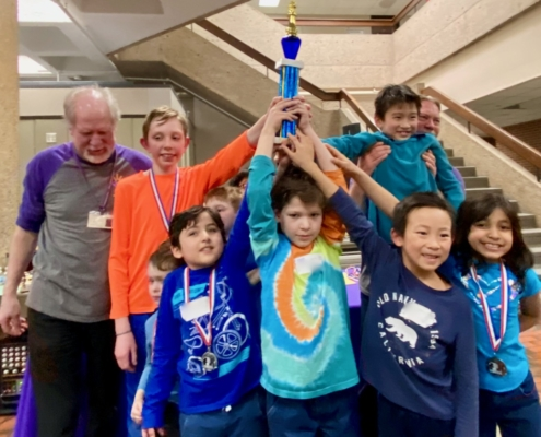Chess kids compete in non-elimination tournaments. This team won first place at a local tournament.