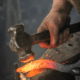 Extreme heat and constant pound by a heavy hammer are required for forging steel.