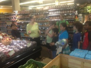 Youth farmers learn about organic food at the Mississippi Market Co-op.