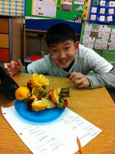 Payton shows off his fruit creation.