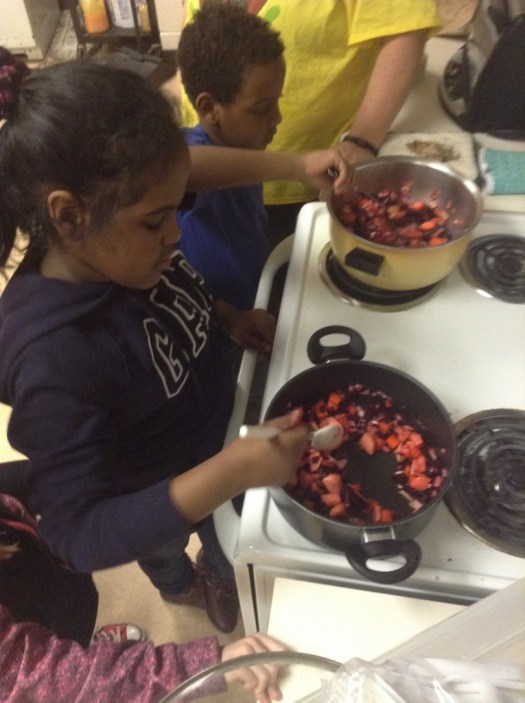 Sayma and Jama cook up Borscht with parent volunteer Adrienne lending a watchful eye