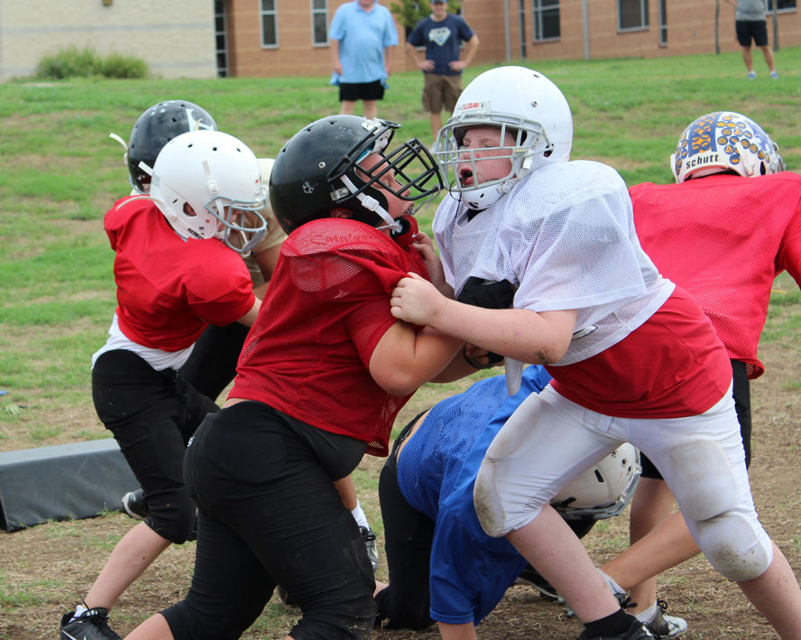 teach blocking youth football offensive lineman