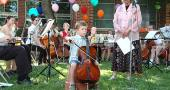 """Shirley Mullins' youngest student, Quentin Branlat, 6, played a measured and tonal """"Twinkle Twinkle Little Star"""" on a quarter size cello while staring straight at his audience the entire performance. (photos by Lauren Heaton)"""