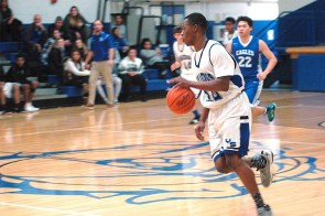 YSHS Varsity boys basketball player James Browning, #24, takes the ball down the court. The Bulldogs hosted hosted Middletown Christian Eagles. (Photo by Matt Minde)