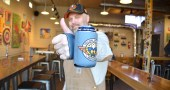 The patent is pending for local entrepreneur Jon Horvath's latest invention, The Can Hand, an ingenious way to hold a beverage while keeping one's fingers free for other tasks, such as texting or holding an umbrella. Horvath will host an open launch party for The Can Hand at Yellow Springs Brewery on Saturday, March 2, from 4 to 8 p.m. with games, raffles and refreshments. The brewery was Horvath's first customer and will start selling their logo-printed Can Hands this weekend. (Photo by Megan Bachman)