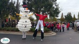strolling balloon entertainer and stilt walker for winter event nutcracker and snowman