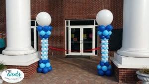 School ribbon cutting event columns