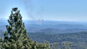 80 fire as seen at 11:48 am from Wolf Mountain lookout. Photo: Julie Siegenthaler