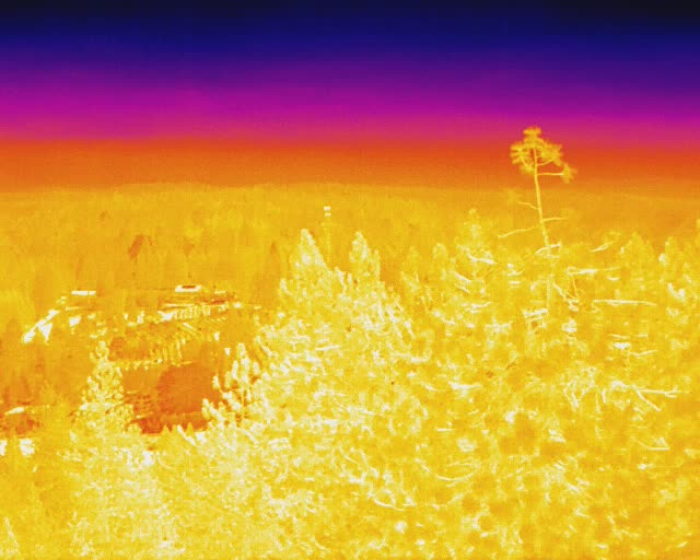 The thermal camera atop Mt. Danaher, California gives firefighters the ability to see through thick smoke that otherwise keeps them from tracking fire progress directly ahead of the fire. The photo shows the view on Saturday, Aug. 28 at 10:12 a.m..