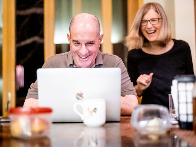 UCSF Prof. David Julius and his wife, UCSF Prof. Holly Ingraham, field messages after learning Julius was awarded the Nobel Prize in Physiology or Medicine on Monday, Oct. 4, 2021, in Walnut Creek, Calif.