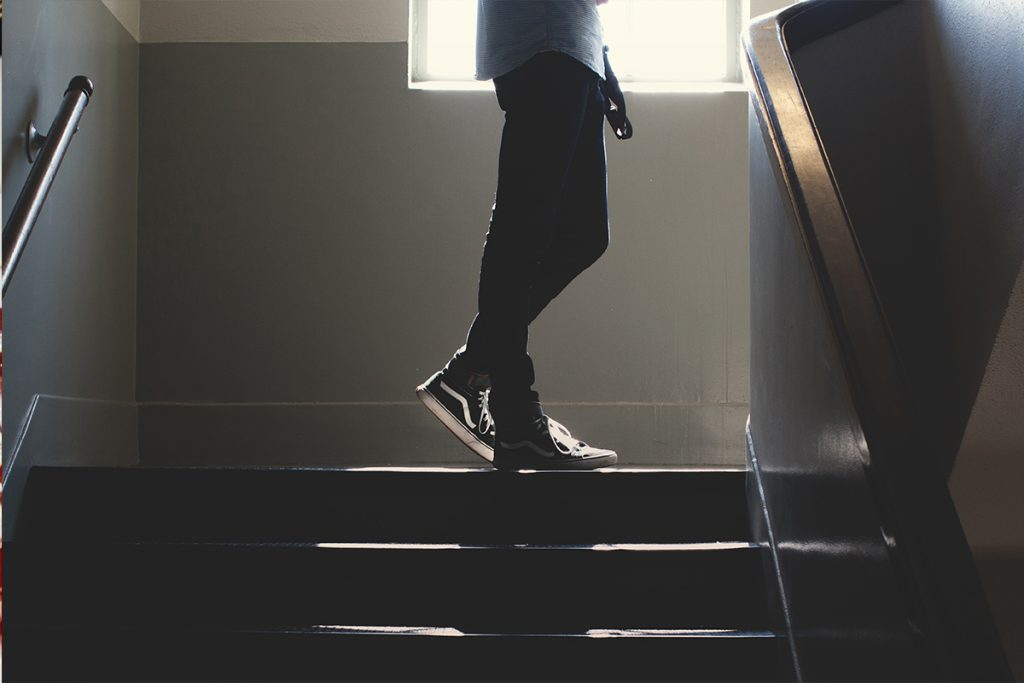 Student walking up stairs