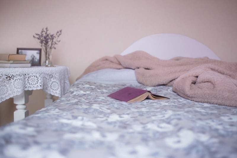 A photo of a book on a bed.