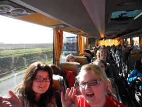 Allie and Josey wave hello on the way to Brussels