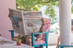 Preferring the newspaper instead of the beach