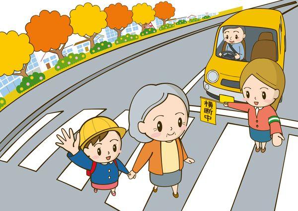 手をつないで横断歩道を渡る