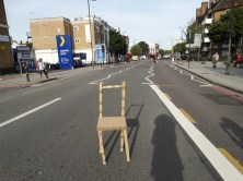 making a cardboard chair and then placing it in public spaces