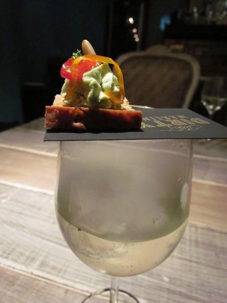 Amuse Bouche atop smoking drink @ The Dirty Martini