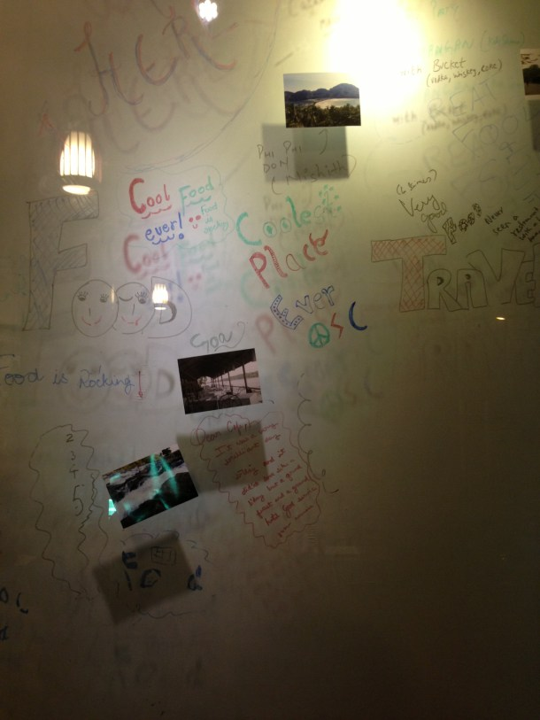 wall full of writing by guests