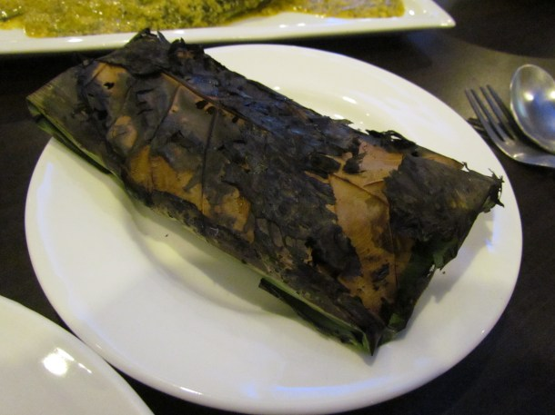 Ilish macher pata pora cooked & served inside a leaf wrap