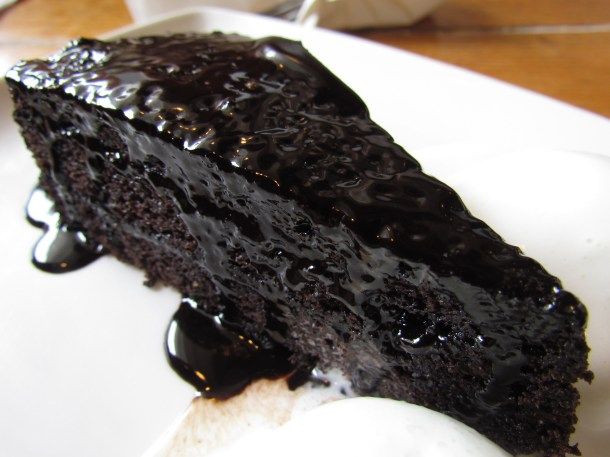 Warm gooey mushy chocolate cake with vanilla ice cream