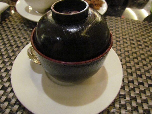 Chicken yakhni shorba served in a covered cup