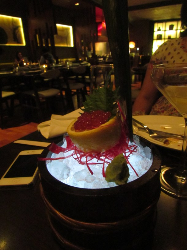 Sashimi served in a vessel lit from within &  topped with ice.