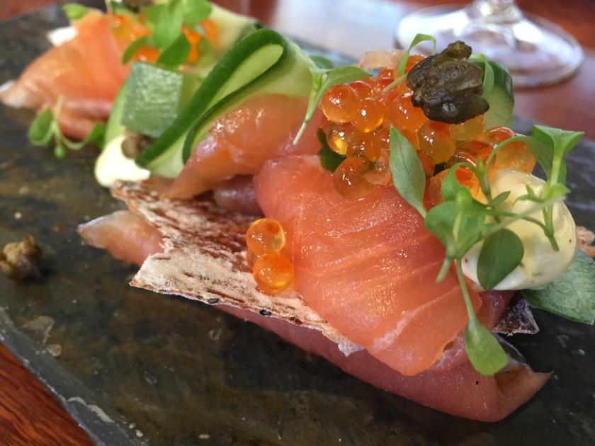 salmon on a toast with caviar garnish