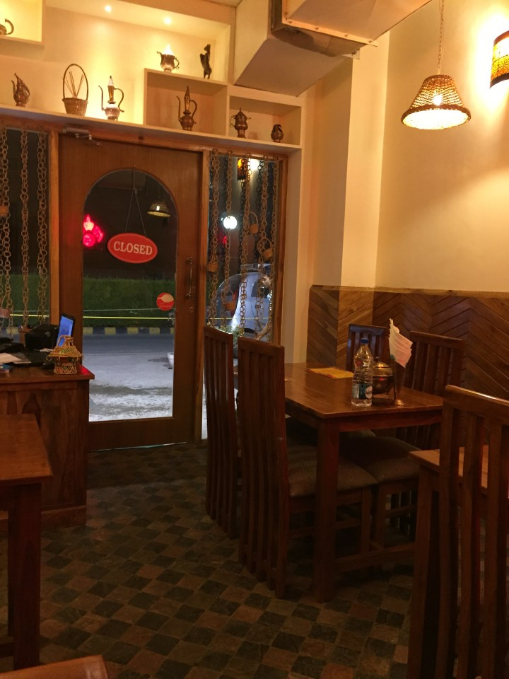 A view of the entrance of the restaurant from inside the restaurant