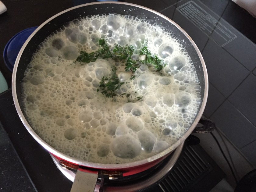 spinach leaves mix being cooked as described below