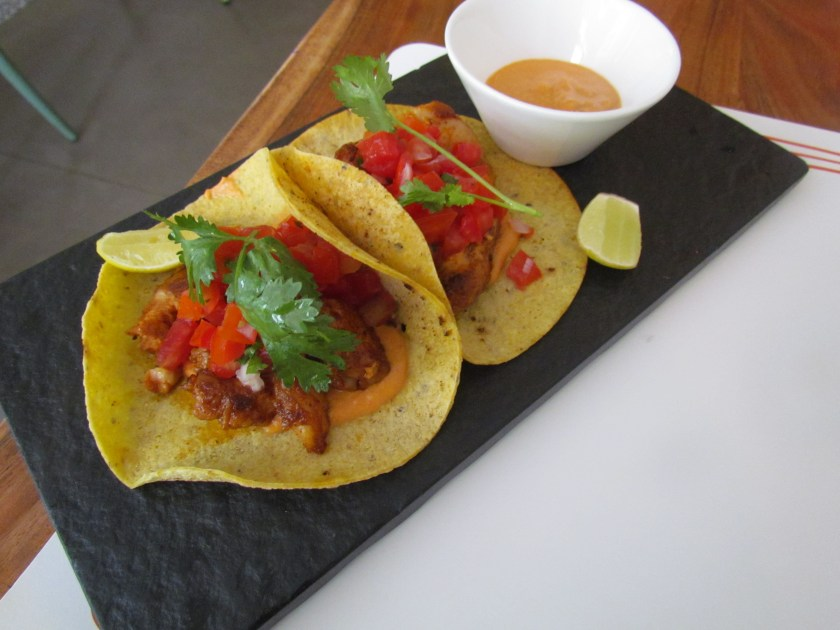 taquitos of Grilled fish marinated with chillies , garlic, ginger & oregano served with almond salsa
