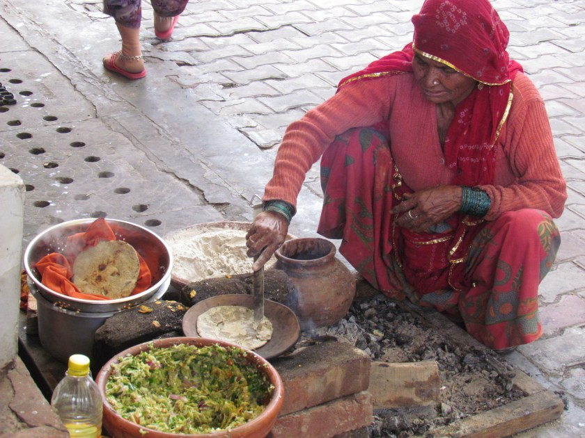 tribal lady making rotis for us