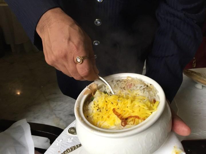dum cooked mutton biryani being served