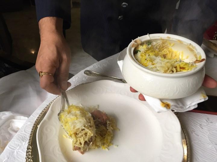 mutton dum biryani being served