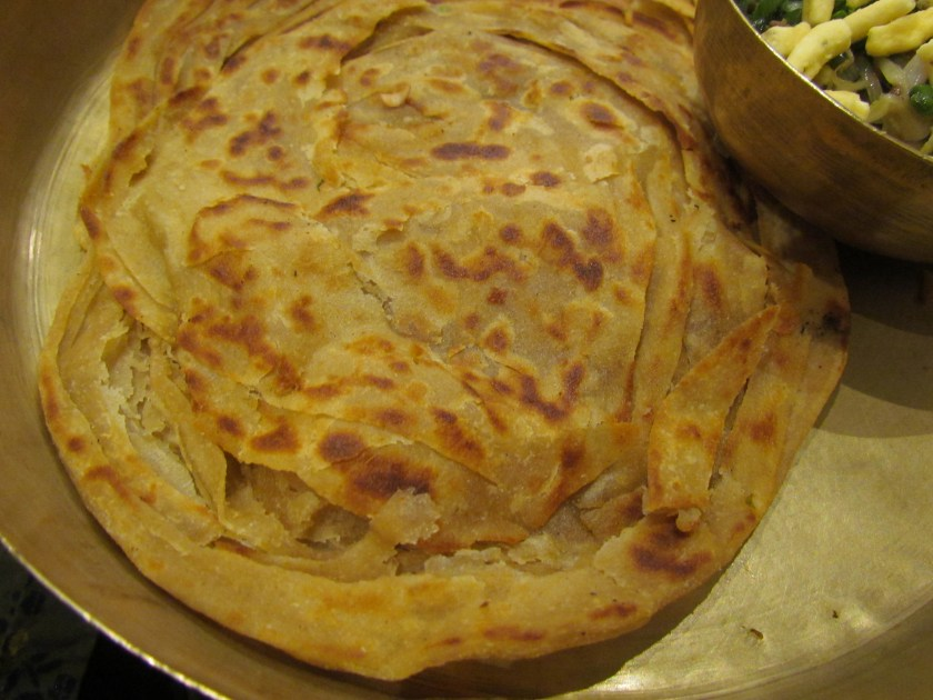 pure ghee paratha served with curry - crisp outside, soft within