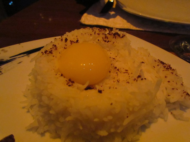 raw egg yolk served on rice - accompaniment to Chelo lamb loin flambé d  in cognac