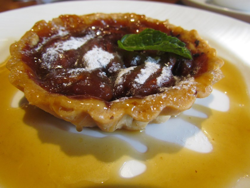 Pecan pie with spiked toffee sauce