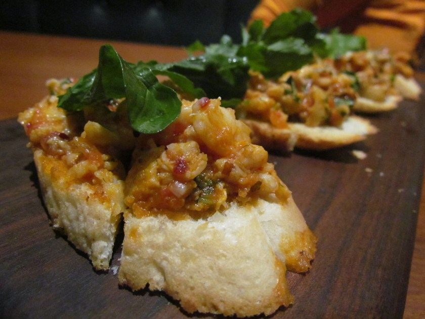 Butter garlic Crab bruschetta with flame roasted pepper