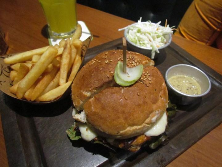 Ground pork burger with sunny side up