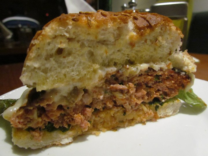 cross section of Ground pork burger with sunny side up