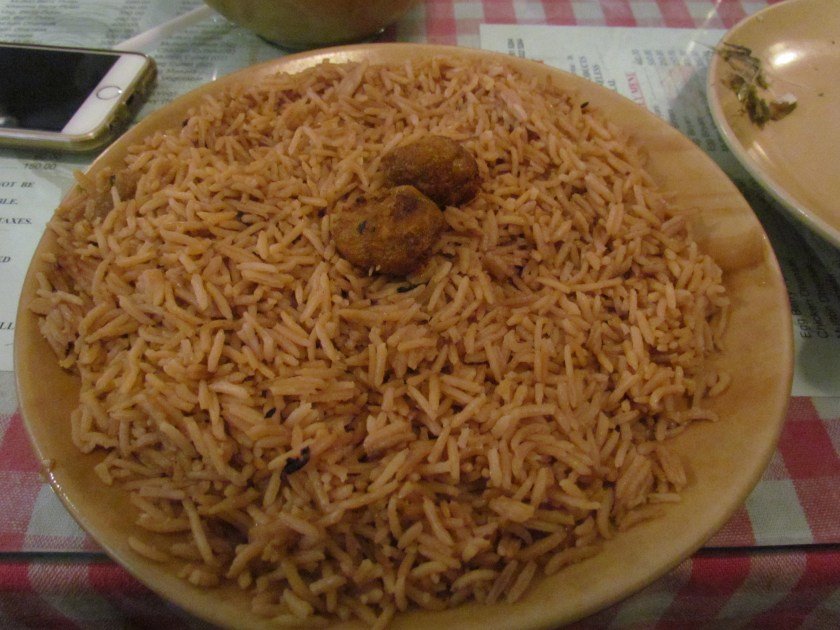 cutlets & browned rice served with dhansak