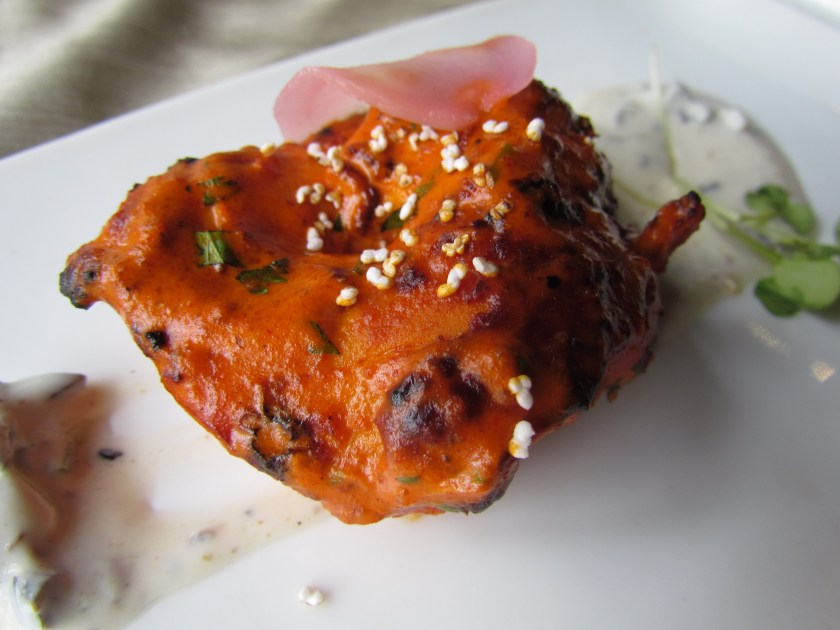 piri piri chicken tikka, black olive and cumin raita and pink ginger