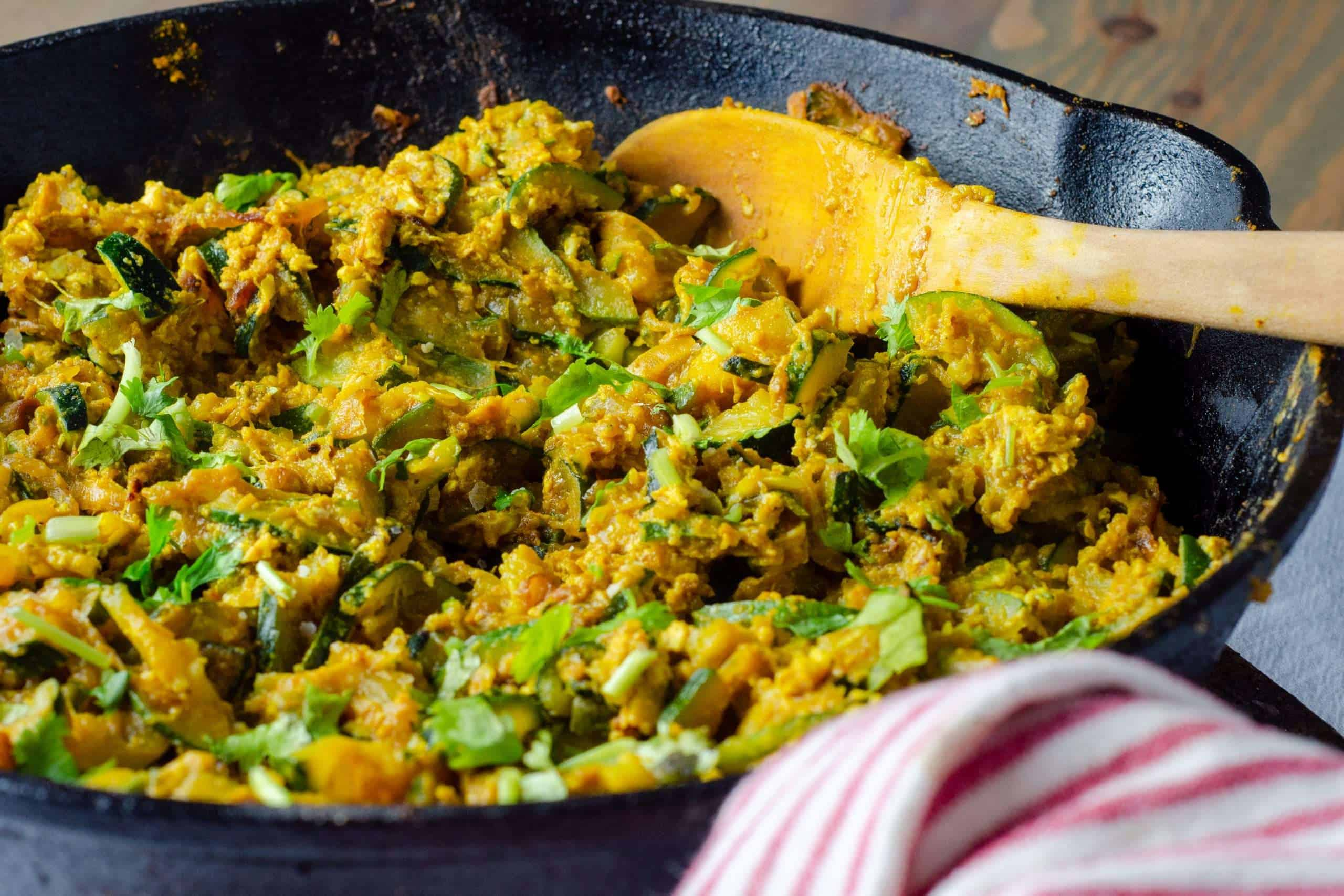 Low Carb Zucchini and Egg Bhaji in a cast iron skillet
