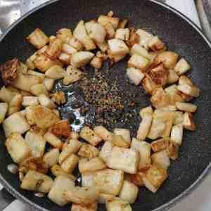 Toasting Panch Phoran with fried celeriac