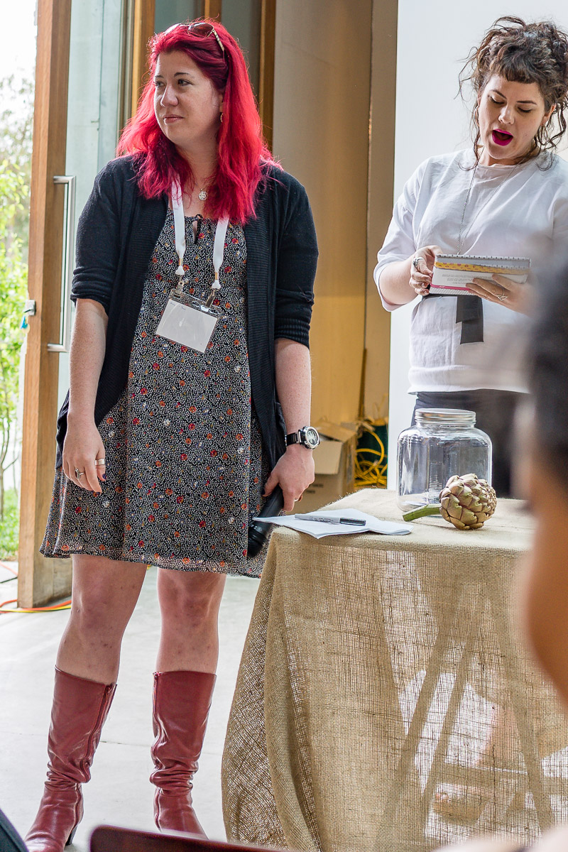 This is a photograph of Tara Cheyne as the MC on Sunday at Eat Drink Blog 6 with Carly Jacobs (Smaggle)