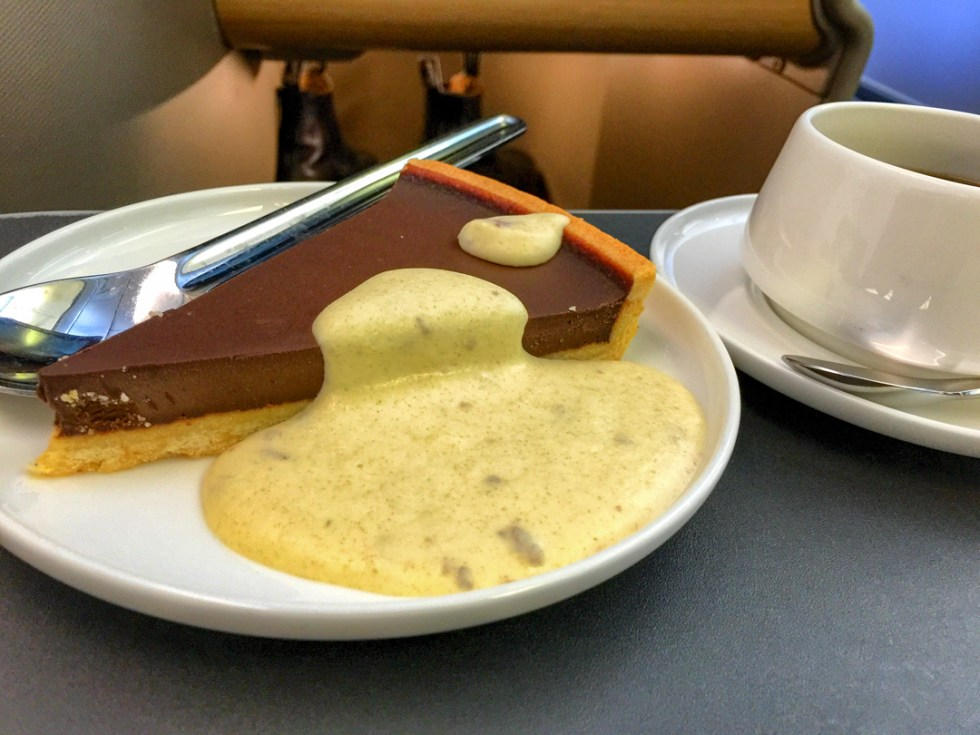Baked chocolate, wattleseed and almond tart with date cream on QF35