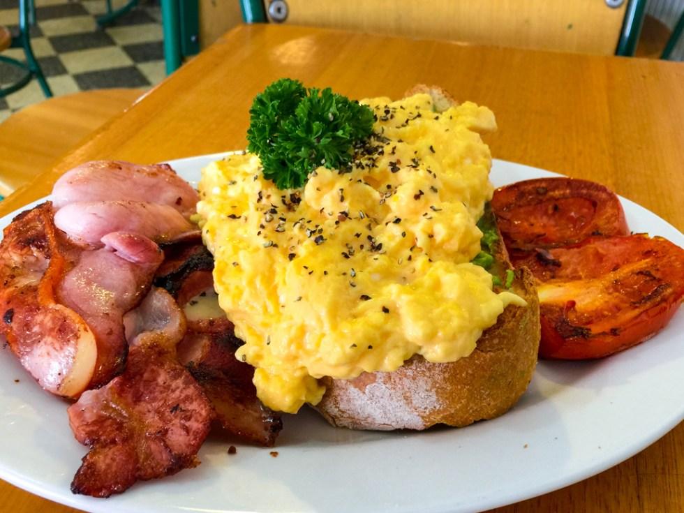 Scrambled eggs with bacon and tomato on avocado sourdough bread from Hides Bakery, Benalla road trip to Bendigo