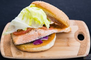 Baked salmon burger with lettuce, curry tomato, red onion, and aioli Gary Lum