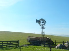 old wind mill and rusted water truck