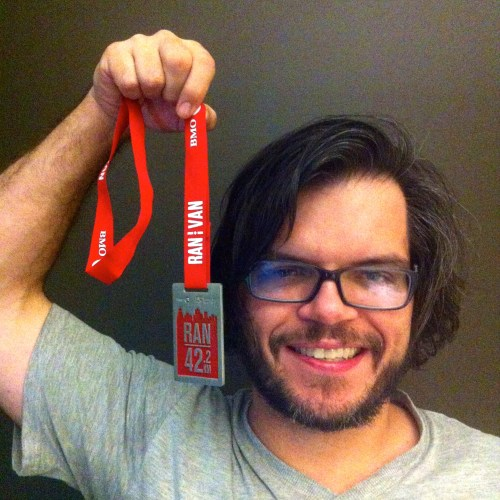 Yuri with 2014 BMO Vancouver Finishers Medal