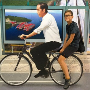 Yves rides a bike with President Yokowi